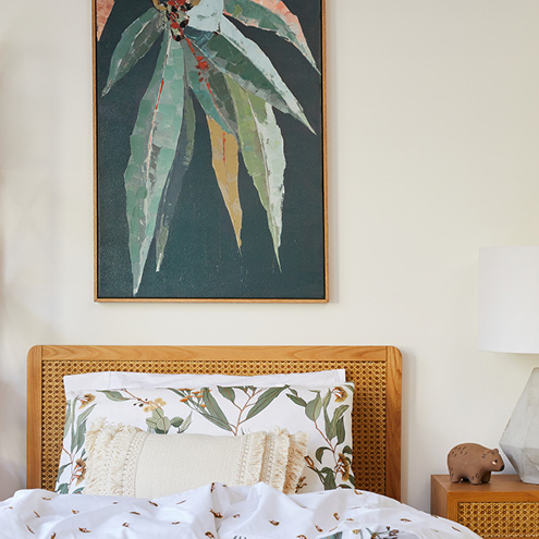 Tip 3: Add Art Above The Bed